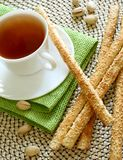 Cup of tea and crispy straw Stock Images