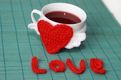 Cup of tea with crochet heart Stock Photos