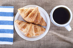 Cup of tea and croissants on a linen fabric background. Rustic Royalty Free Stock Image