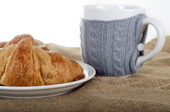 Cup of tea and croissants on a linen fabric background. Still life Stock Photos