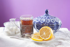 Cup of tea in the cup holder, blue sugar bowl and saucer with a Stock Photos