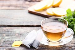 Cup of tea. With teabags on wooden table stock image