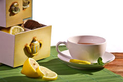 Cup of tea and Cupboard with lemon Stock Photo