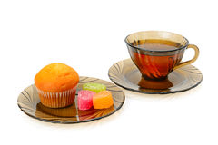 Cup of tea, cupcake and marmalade  on white background Royalty Free Stock Images