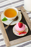 Cup of tea and cupcake with strawberry Royalty Free Stock Image