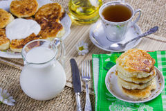Cup with tea, curd pancakes. On a dish and milk Royalty Free Stock Photos