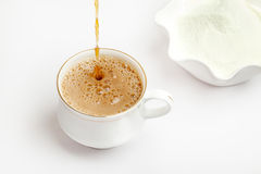 Cup of tea with dairy milk powder Stock Photography