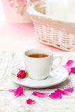 Cup of tea decorated with rose petals Stock Photos