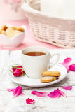 Cup of tea decorated with rose petals Stock Photo