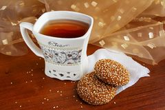 A cup of tea with delicious sweets on the table stock images