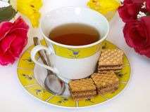 Cup of tea with dessert. Royalty Free Stock Photography
