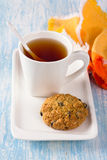 Cup of tea with diet oatmeal cookies on a white plate Royalty Free Stock Images