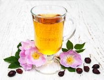 Cup of tea and dogrose Royalty Free Stock Photos