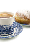 Cup of tea and donut. There is a cup of tea and donut isolated on the white background Royalty Free Stock Image