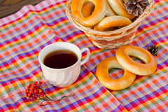 Cup of tea and donut on a napkin in a cage. Vintage Russian samovar with a great cup of tea on a wooden background stock photo