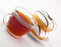 Cup of tea with donuts Royalty Free Stock Images