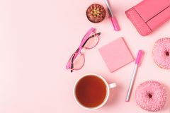 Cup of tea with donuts on a pink pastel background Royalty Free Stock Images