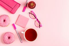 Cup of tea with donuts on a pink pastel background Stock Photography