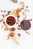 Cup of tea with dried apples, spices, fruits Royalty Free Stock Photography