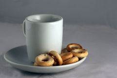 A cup of tea and dried biscuits Stock Photos