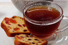 Cup of tea with dried fruit cake Stock Images