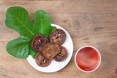 Cup Of Tea. Dried Fruits. Wooden Background. Royalty Free Stock Images