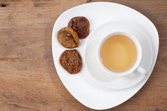 Cup Of Tea. Dried Fruits. Wooden Background. Royalty Free Stock Photos