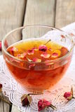 Cup of tea with dried roses Royalty Free Stock Photography