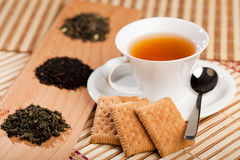 Cup of tea and dried tea leaves Royalty Free Stock Photo