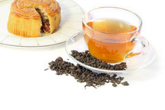 Cup of tea, dried tea leaves and mooncake, chinese traditional. Royalty Free Stock Image