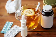Cup of tea, drugs, honey and paper tissue on wood Royalty Free Stock Photography