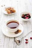 Cup of tea with dry rose buds Royalty Free Stock Photo