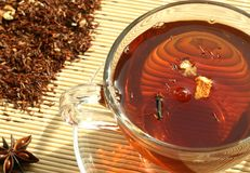 The cup of the tea and the dry tea royalty free stock photos