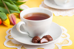 A Cup of Tea with Easter Egg Shaped Chocolate Candies Royalty Free Stock Images