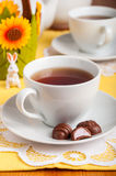A Cup of Tea with Easter Egg Shaped Chocolate Candies Royalty Free Stock Image