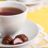 A Cup of Tea with Easter Egg Shaped Chocolate Candies Royalty Free Stock Photography