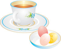 Cup with tea and Easter eggs Stock Photo