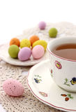 Cup of tea and easter eggs on white Stock Photography