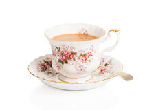 Cup Of Tea. Cup of English breakfast tea in vintage teacup and saucer with antique spoon on a white background Stock Photo