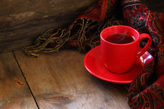 Cup of tea with fashion scarf on wooden table Stock Images