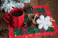 Cup of tea, fir cones, fir branches in the snow Royalty Free Stock Photography