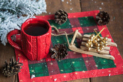 Cup of tea, fir cones, fir branches in the snow Stock Photo
