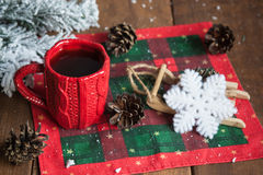 cup of tea, fir cones, fir branches in the snow Stock Image