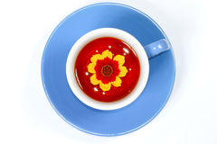 The cup of tea with flower. The cup of tea with nice flower Stock Photo