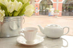 Cup of tea and flower Stock Image