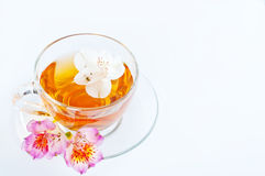 Cup of tea with  flowers Stock Images