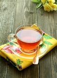 Cup of tea and flowers on old wooden Royalty Free Stock Photo