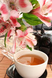 Cup of tea and flowers. Cup of tea, teapot and flowers Royalty Free Stock Images