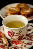 Tea with muffins. A cup of tea in the foreground and a plate with muffins in a blurry background Stock Photos