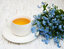 Cup of tea and forget me not flowers Royalty Free Stock Photo